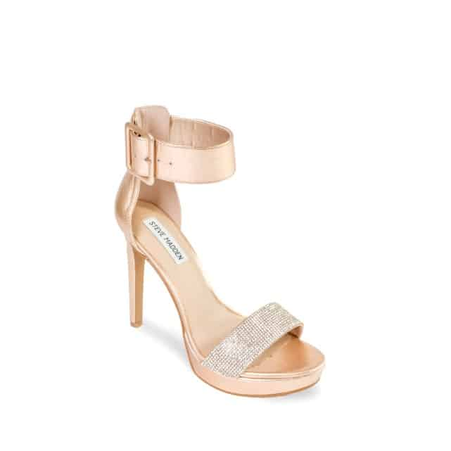 Rose gold female heel with ankle strap.