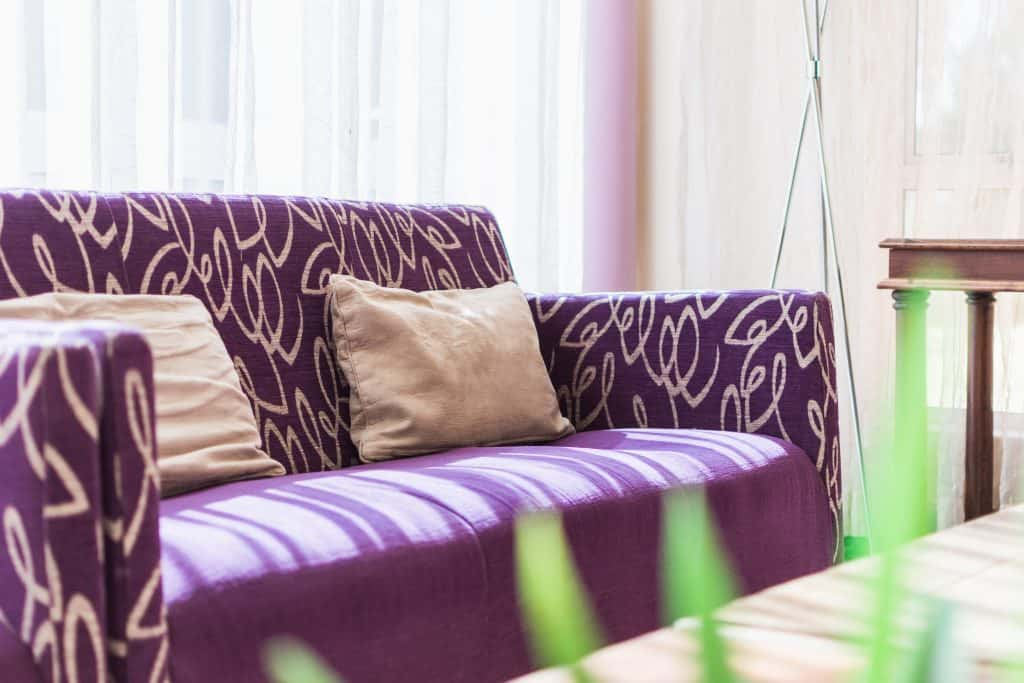 Hotel full feature photography purple couch in reception with light
