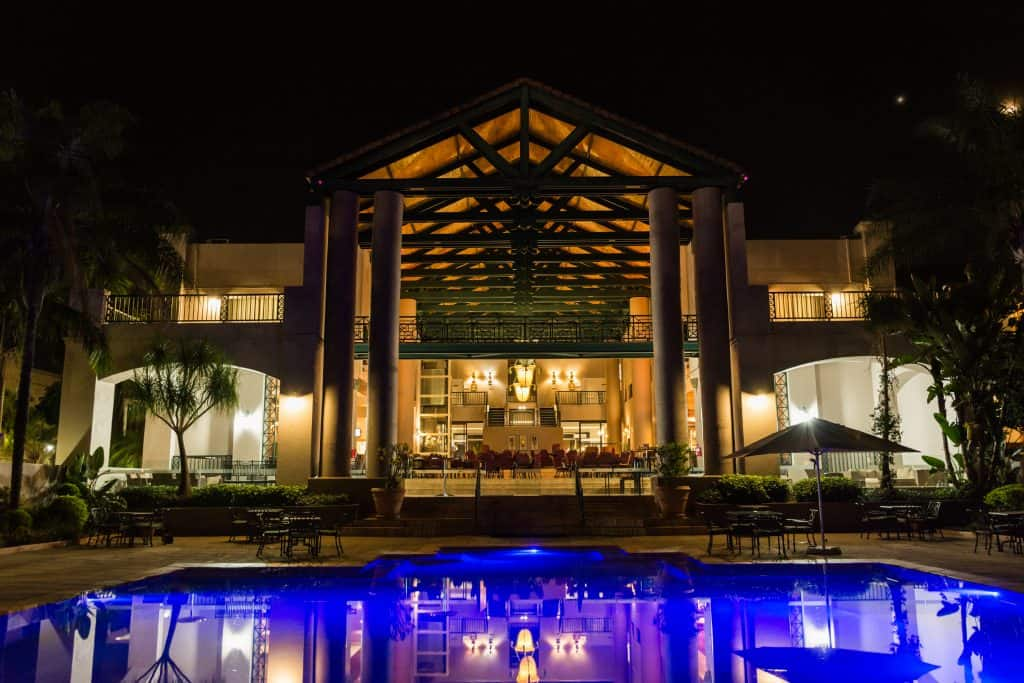 Hotel full feature photography exterior with blue lit pool in foreground