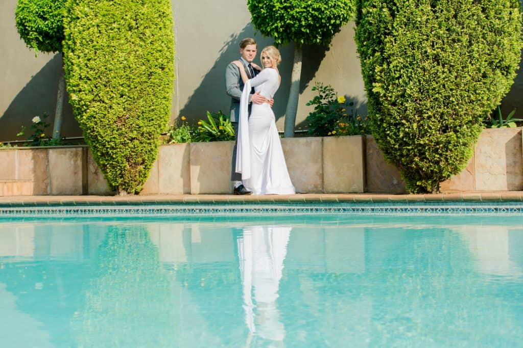 Couple posing at swimming pool - lifestyle photography.