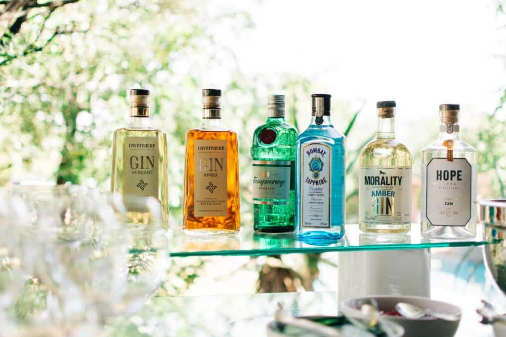 Gin bottles lined on outdoor bar - lifestyle photography.