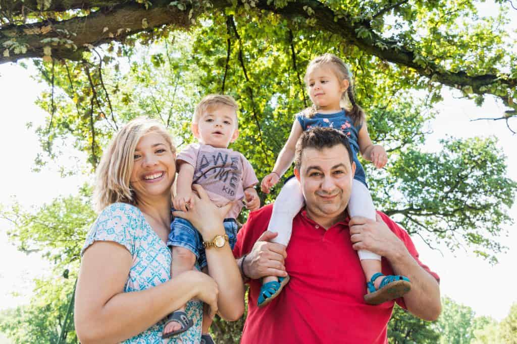 Family in park with trees and light - lifestyle photography.