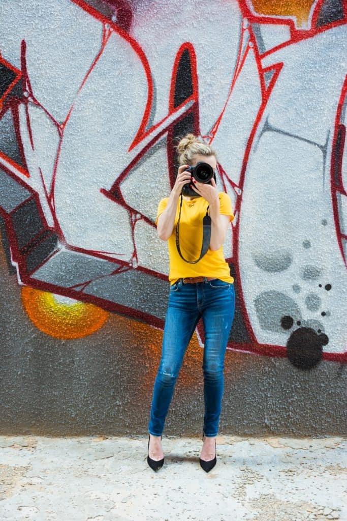 Photographer posing with camera - personal branding photography.