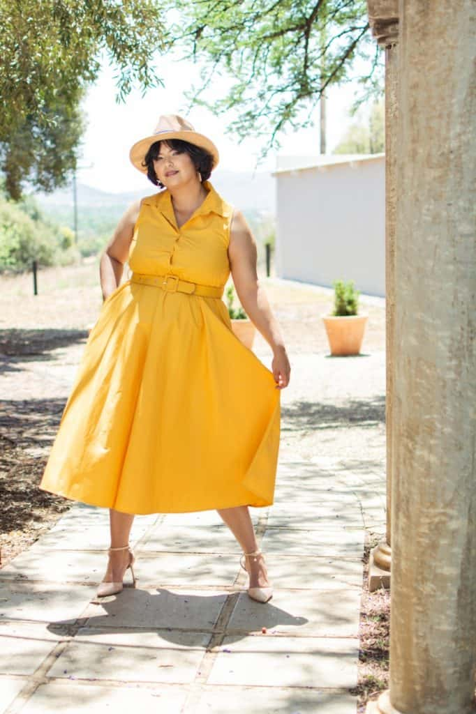 Lady in yellow dress standing outside
