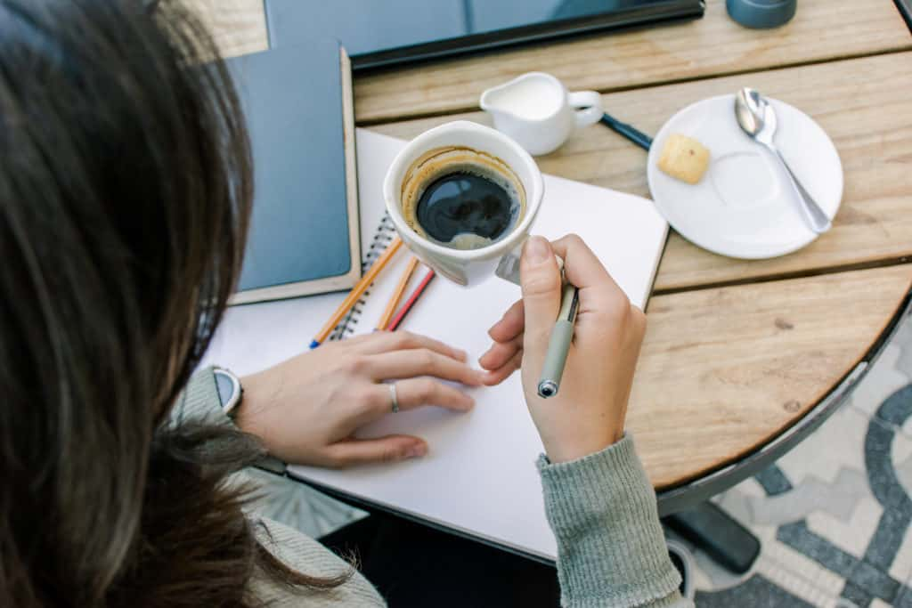 Personal branding stories - Lady working at desk with coffee